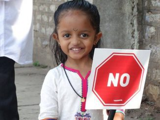 A child holds up a placard in Bellary, Bengaluru, participating in the citizens' protest against a proposed steel flyover. Pic: Shree DN